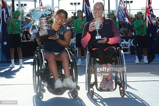 Yui Kamiji of Japan celebrates with the trophy after winning the Women's Wheelchair Singles Final against Jiske Griffioen of the Netherlands holding...