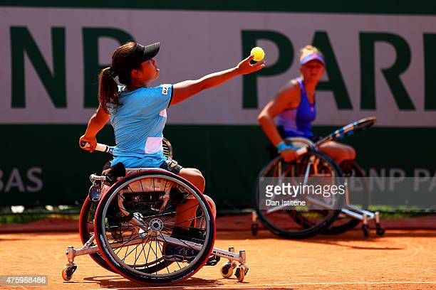 Yui Kamiji of Japan in action next to her partner Jordanne Whiley of Great Britain during their women's wheelchair doubles final match against Jiske...