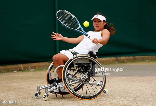 Yui Kamiji of Japan in action partnering Jordanne Whiley of Great Britain in the Wheelchair Ladies Doubles Final against Jiske Griffioen and Aniek...