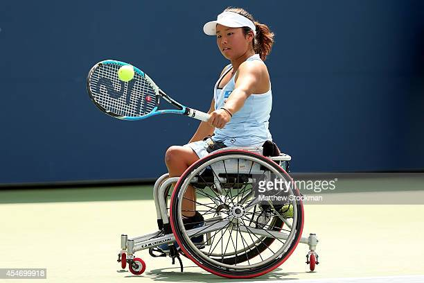 Yui Kamiji of Japan returns a shot against Jiske Griffioen of the Netherlands during their wheelchair women's singles semifinal match on Day Twelve...