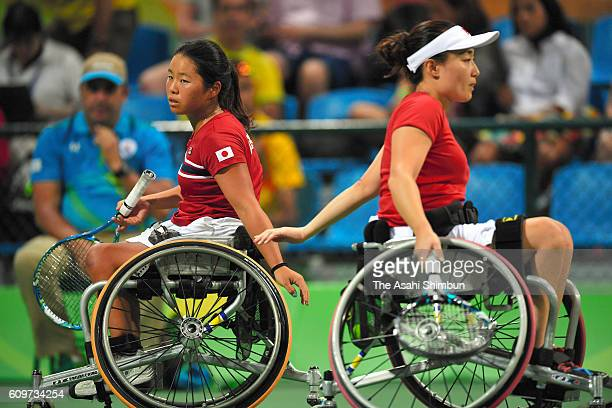 Yui Kamji and Miho Nijo of Japan low fives in the Women's Doubles Bronze Medal Match against Lucy Shuker and Jordanne Whiley of Great Britain on day...