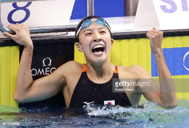 Yui Ohashi celebrates after winning the silver in the women's 200 meters individual medley in a new Japanese record of 2 minutes 791 seconds during...
