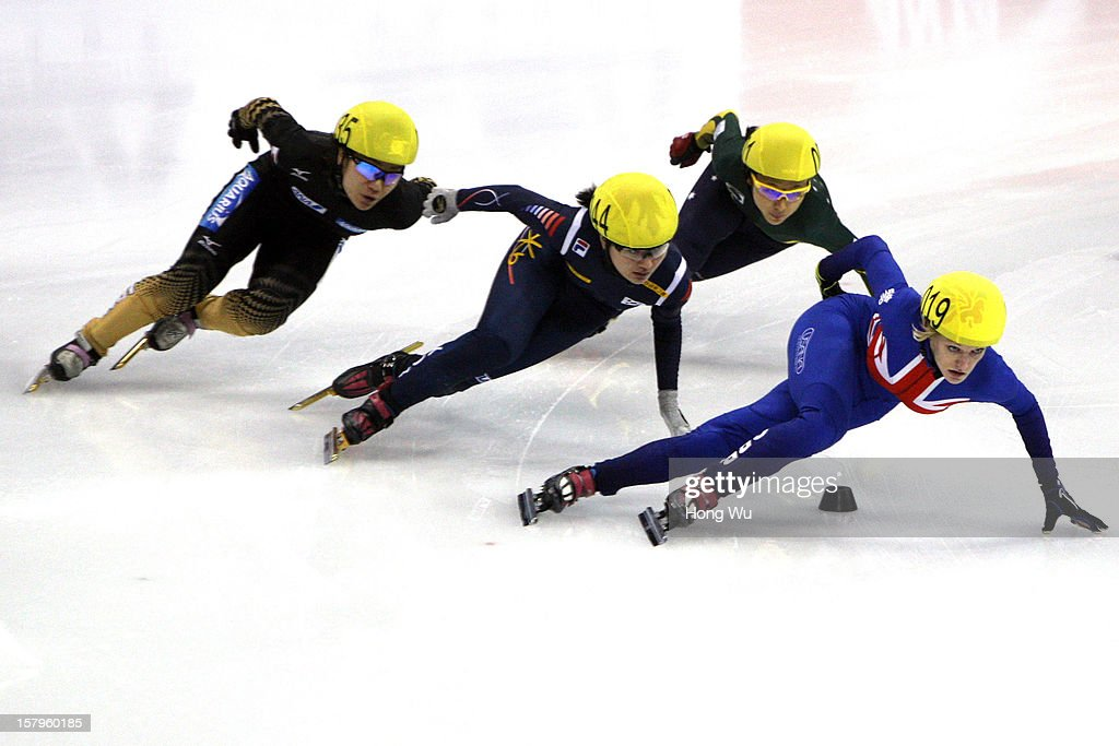 Yui Sakai of Japan, Seung-Hi Park of Korea, Julie Jung of Australia, Elise Christie of Great Britain compete in the Women's 1000m Quarter final during the day one of the ISU World Cup Short Track at the Oriental Sports Center on December 8, 2012 in Shanghai, China.