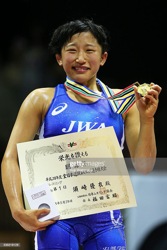 Yui Suzaki celebrates at the award ceremony for the Women's 48kg free style final match during the All Japan Wrestling Championships at Yoyogi National Gymnasium on May 29, 2016 in Tokyo, Japan.