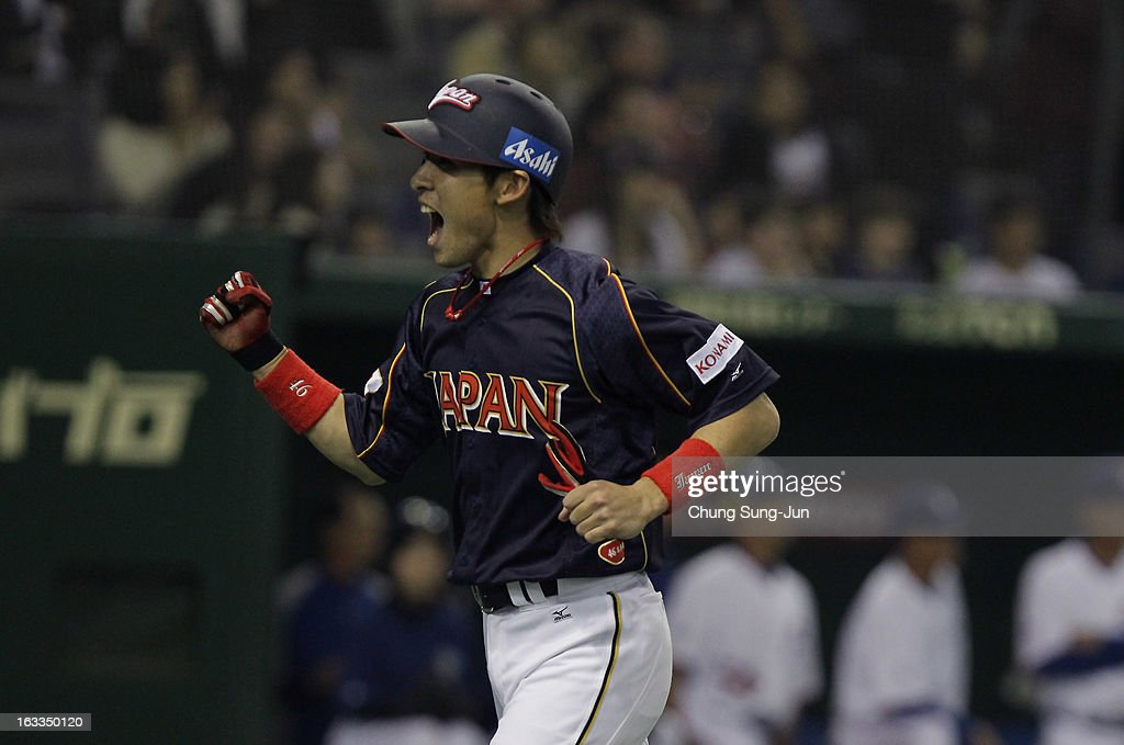 <a gi-track='captionPersonalityLinkClicked' href=/galleries/search?phrase=Yuichi+Honda&family=editorial&specificpeople=8673839 ng-click='$event.stopPropagation()'>Yuichi Honda</a> # 46 of Japan reacts after scoring in the eighth inning during the World Baseball Classic Second Round Pool 1 game between Japan and Chinese Taipei at Tokyo Dome on March 8, 2013 in Tokyo, Japan.