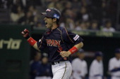 Yuichi Honda of Japan reacts after scoring in the eighth inning during the World Baseball Classic Second Round Pool 1 game between Japan and Chinese...