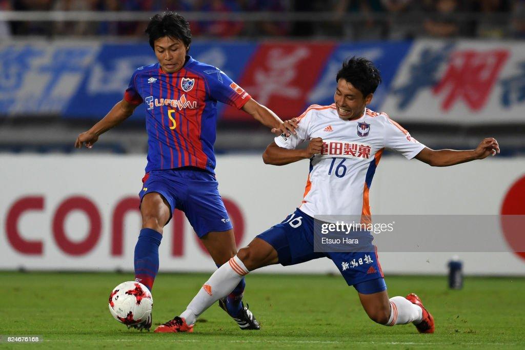Yuichi Maruyama of FC Tokyo (L) and Shu Hiramatsu of Albirex Niigata compete for the ball during the J.League J1 match between FC Tokyo and Albirex Niigata at Ajinomoto Stadium on July 30, 2017 in Chofu, Tokyo, Japan.