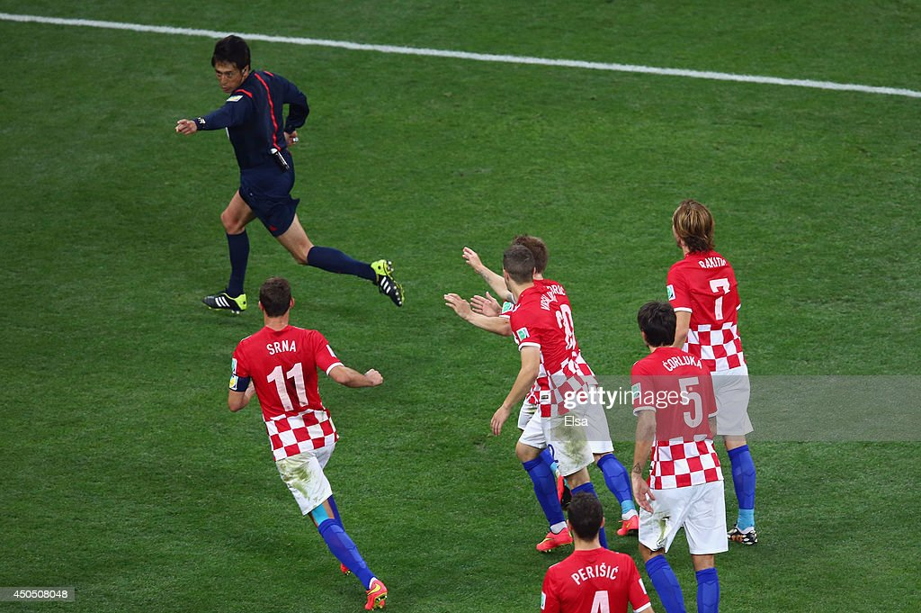 <a gi-track='captionPersonalityLinkClicked' href=/galleries/search?phrase=Yuichi+Nishimura&family=editorial&specificpeople=5759874 ng-click='$event.stopPropagation()'>Yuichi Nishimura</a> awards a penalty kick as <a gi-track='captionPersonalityLinkClicked' href=/galleries/search?phrase=Darijo+Srna&family=editorial&specificpeople=546578 ng-click='$event.stopPropagation()'>Darijo Srna</a>, <a gi-track='captionPersonalityLinkClicked' href=/galleries/search?phrase=Sime+Vrsaljko&family=editorial&specificpeople=7191685 ng-click='$event.stopPropagation()'>Sime Vrsaljko</a>, <a gi-track='captionPersonalityLinkClicked' href=/galleries/search?phrase=Luka+Modric&family=editorial&specificpeople=560350 ng-click='$event.stopPropagation()'>Luka Modric</a>, <a gi-track='captionPersonalityLinkClicked' href=/galleries/search?phrase=Vedran+Corluka&family=editorial&specificpeople=1462334 ng-click='$event.stopPropagation()'>Vedran Corluka</a> and <a gi-track='captionPersonalityLinkClicked' href=/galleries/search?phrase=Ivan+Rakitic&family=editorial&specificpeople=3987920 ng-click='$event.stopPropagation()'>Ivan Rakitic</a> of Croatia pursue him during the 2014 FIFA World Cup Brazil Group A match between Brazil and Croatia at Arena de Sao Paulo on June 12, 2014 in Sao Paulo, Brazil.