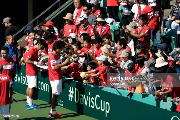 Yuichi Sugita and Go Soeda of Japan sign autographs for fans after the team's 31 victory against Brazil during day four of the Davis Cup World Group...