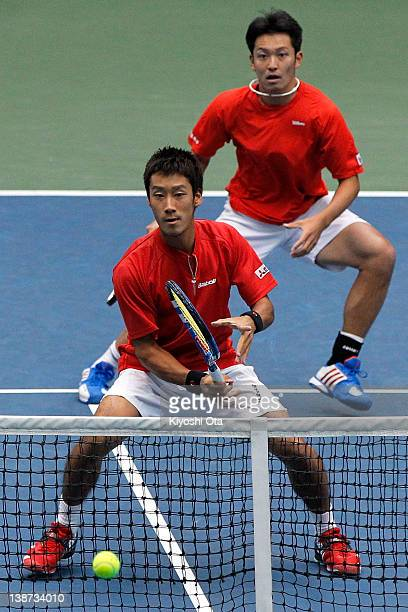 Yuichi Sugita and Tatsuma Ito of Japan play in their doubles match against Ivo Karlovic and Ivan Dodig of Croatia during day two of the Davis Cup...