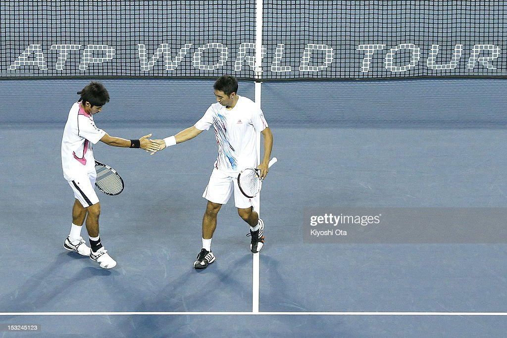 Yuichi Sugita (L) and Yasutaka Uchiyama of Japan celebrate a point in their first round doubles match against Daniele Bracciali of Italy and Frantisek Cermak of the Czech Republic during day two of the Rakuten Open at Ariake Colosseum on October 2, 2012 in Tokyo, Japan.