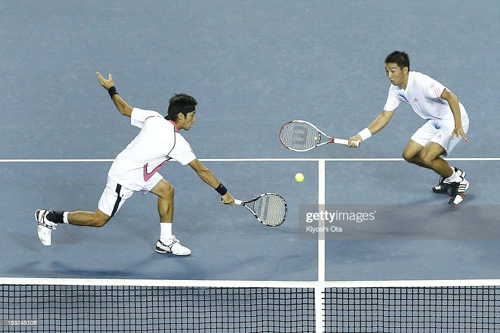 Yuichi Sugita (L) and Yasutaka Uchiyama of Japan play in their first round doubles match against Daniele Bracciali of Italy and Frantisek Cermak of the Czech Republic during day two of the Rakuten Open at Ariake Colosseum on October 2, 2012 in Tokyo, Japan.