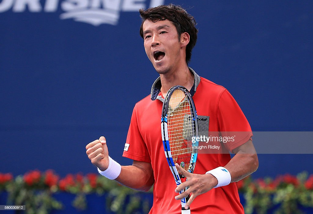 Yuichi Sugita of Japan celebrates a point against Grigor Dimitrov of Bulgaria during Day 1 of the Rogers Cup at the Aviva Centre on July 25 2016 in...