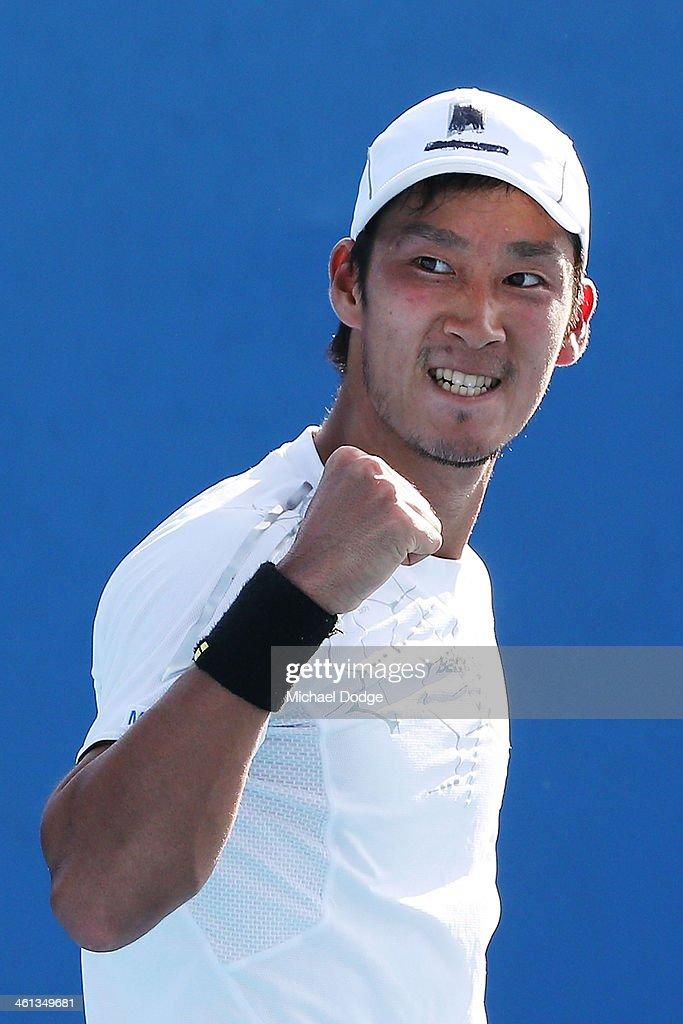 Yuichi Sugita of Japan celebrates a point in his match against Yasutaka Uchiyama of Japan during qualifying for the 2014 Australian Open at Melbourne...