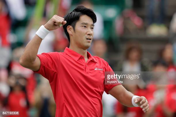 Yuichi Sugita of Japan celebrates after winning his singles match against Guilherme Clezar of Brazil during day one of the Davis Cup World Group...