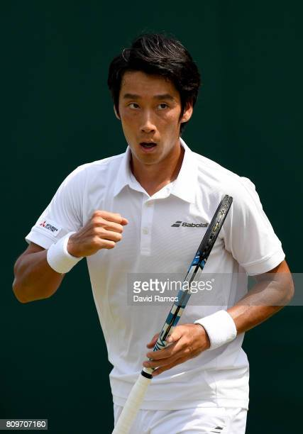 Yuichi Sugita of Japan celebrates during the Gentlemen's Singles second round match against Adrian Mannarino of France on day four of the Wimbledon...