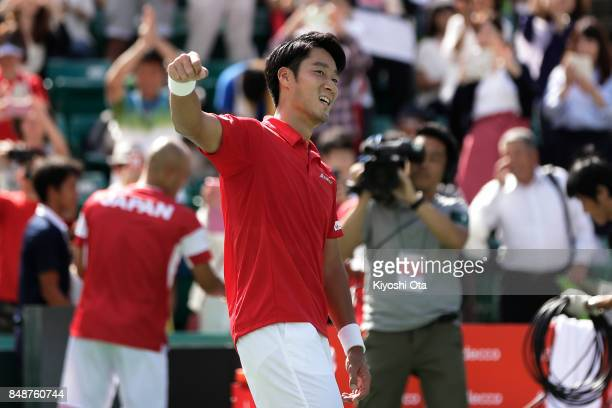 Yuichi Sugita of Japan celebrates the team's 31 victory after winning his singles match against Thiago Monteiro of Brazil during day four of the...