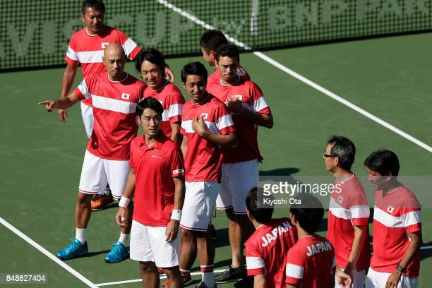 Yuichi Sugita of Japan celebrates the team's 31 victory against Brazil with his team mates during day four of the Davis Cup World Group Playoff...