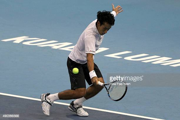 Yuichi Sugita of Japan competes against Matteo Donati of Italy during the 2015 ATP Malaysian Open at Bukit Jalil National Stadium on September 28...