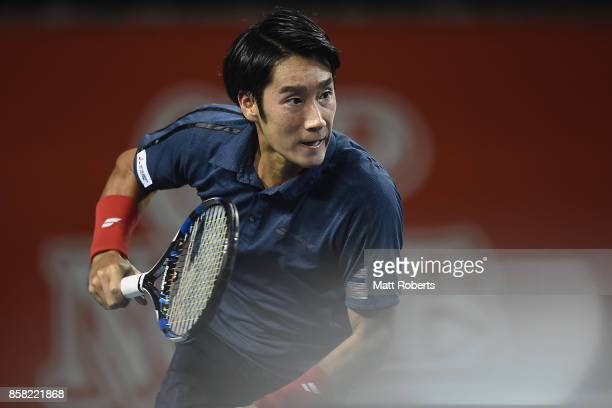 Yuichi Sugita of Japan competes for the ball in his quarterfinal match against Adrian Mannarino of France during day five of the Rakuten Open at...