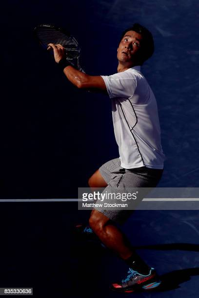 Yuichi Sugita of Japan fades back for a shot while playing Grigor Dimitrov of Bulgaria during day 7 of the Western Southern Open at the Lindner...