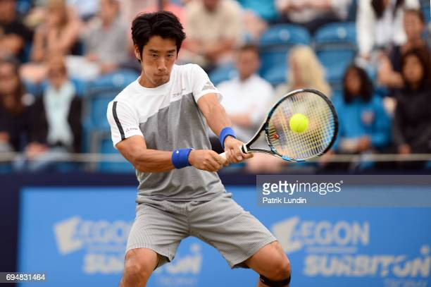 Yuichi Sugita of Japan hits a backhand during the final match against Jordan Thompson of Australia during the Aegon Surbiton Trophy tennis event on...