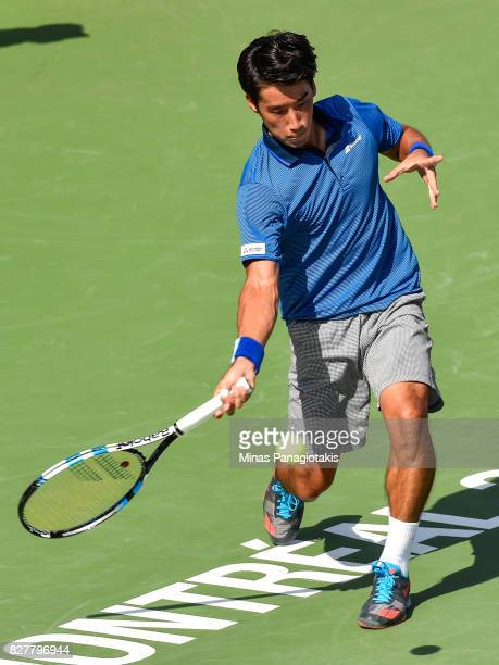 Yuichi Sugita of Japan hits a return against David Goffin of Belgium during day five of the Rogers Cup presented by National Bank at Uniprix Stadium...