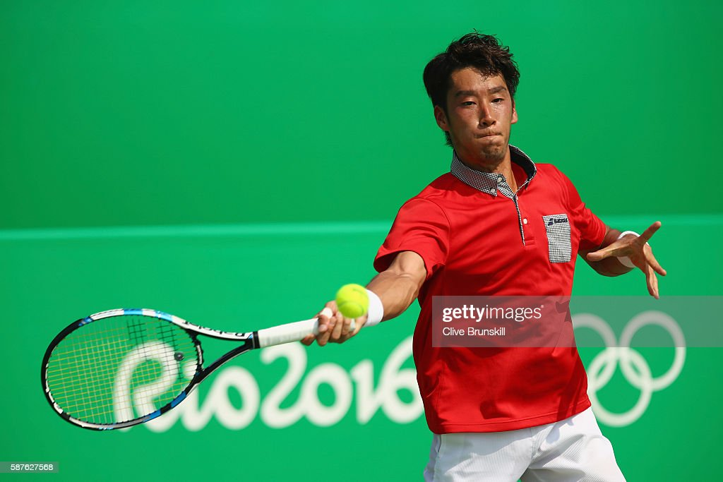 Yuichi Sugita of Japan hits during the men's second round singles match against Gilles Simon of France on Day 4 of the Rio 2016 Olympic Games at the...