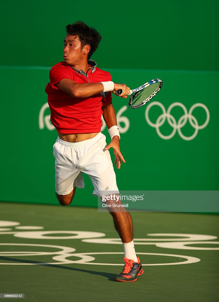 Yuichi Sugita of Japan in action against Brian Baker of the United States in their first round match on Day 1 of the Rio 2016 Olympic Games at the...