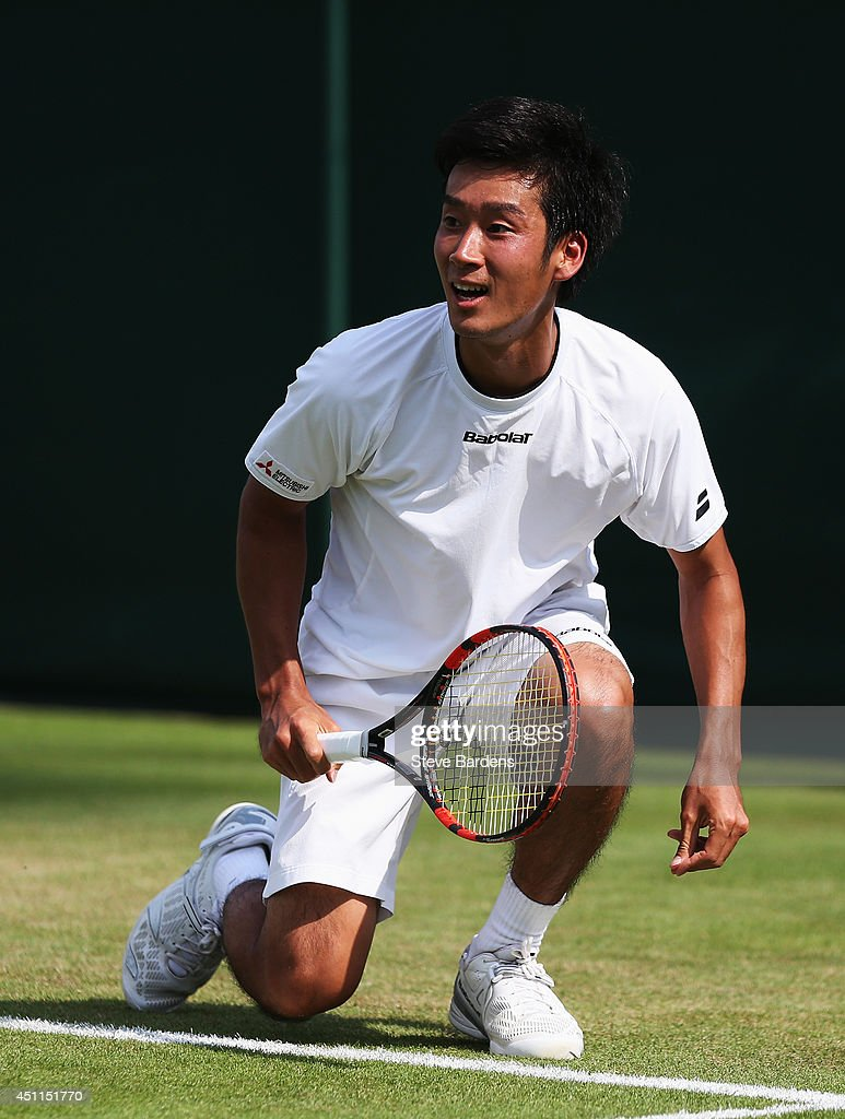 <a gi-track='captionPersonalityLinkClicked' href=/galleries/search?phrase=Yuichi+Sugita&family=editorial&specificpeople=2081175 ng-click='$event.stopPropagation()'>Yuichi Sugita</a> of Japan in action during his Gentlemen's Singles first round match against Feliciano Lopez of Spain on day two of the Wimbledon Lawn Tennis Championships at the All England Lawn Tennis and Croquet Club at Wimbledon on June 24, 2014 in London, England.