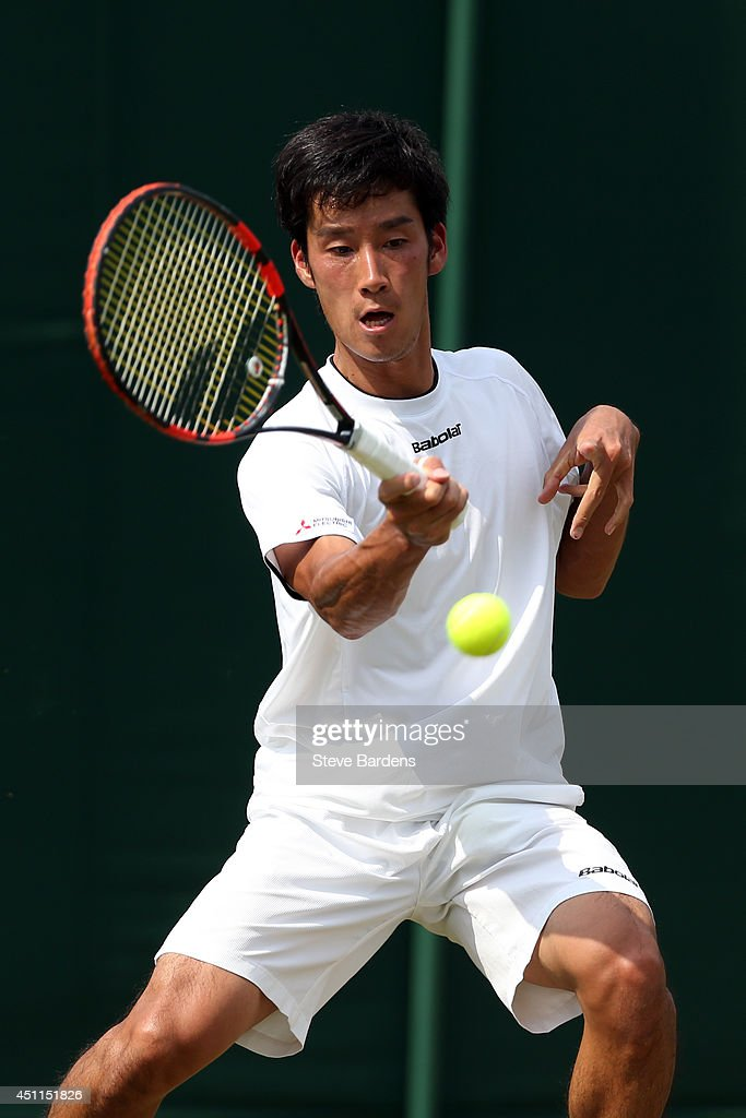 Yuichi Sugita of Japan in action during his Gentlemen's Singles first round match against Feliciano Lopez of Spain on day two of the Wimbledon Lawn...
