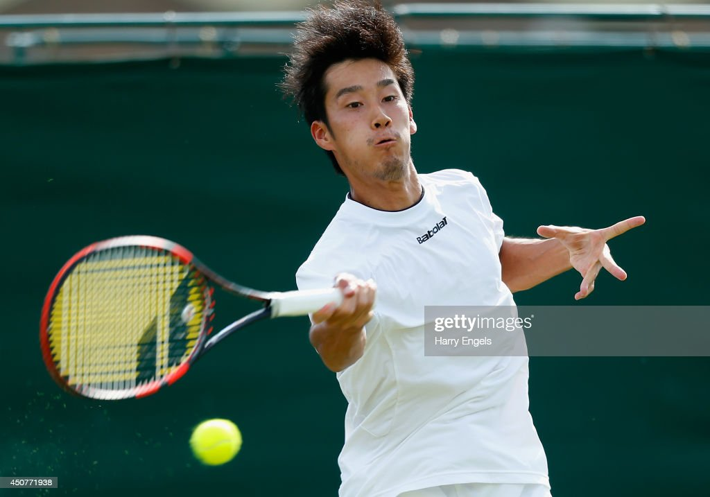 <a gi-track='captionPersonalityLinkClicked' href=/galleries/search?phrase=Yuichi+Sugita&family=editorial&specificpeople=2081175 ng-click='$event.stopPropagation()'>Yuichi Sugita</a> of Japan in action during his second round qualifying match against Germain Gigounon of Belgium on day two of the Wimbledon Championships 2014 Qualifying at the Bank of England Sports Centre on June 17, 2014 in London, England.