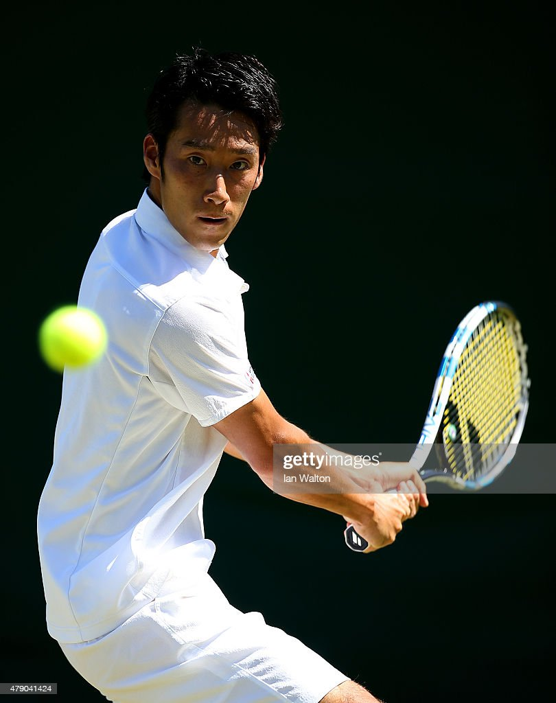 Yuichi Sugita of Japan in action in his Gentlemen's Singles first round match against Blaz Kavcic of Slovenia during day two of the Wimbledon Lawn Tennis Championships at the All England Lawn Tennis and Croquet Club on June 30, 2015 in London, England.