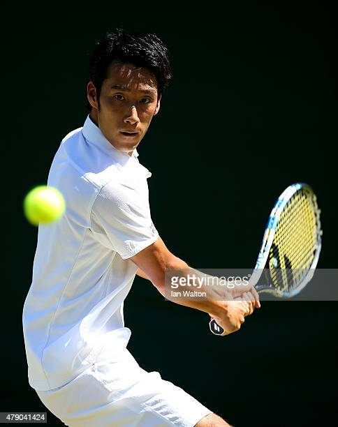 Yuichi Sugita of Japan in action in his Gentlemen's Singles first round match against Blaz Kavcic of Slovenia during day two of the Wimbledon Lawn...