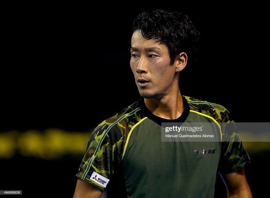 Yuichi Sugita of Japan looks on against Mischa Zverev of Germany during day one of the ATP World Tour Valencia Open tennis tournament at the Ciudad...