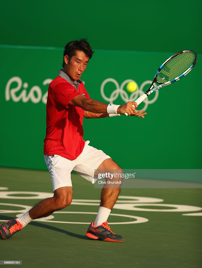 Yuichi Sugita of Japan plays a backhand against Brian Baker of the United States in their first round match on Day 1 of the Rio 2016 Olympic Games at...