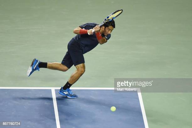 Yuichi Sugita of Japan plays a backhand against Milos Raonic of Canada during day four of the Rakuten Open at Ariake Coliseum on October 5 2017 in...