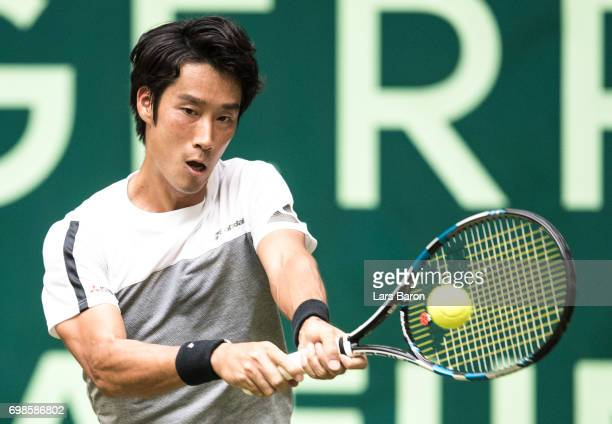 Yuichi Sugita of Japan plays a backhand during his match against Roger Federer of Switzerland during Day 4 of the Gerry Weber Open 2017 at on June 20...