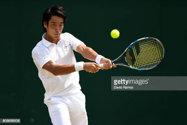 Yuichi Sugita of Japan plays a backhand during the Gentlemen's Singles second round match against Adrian Mannarino of France on day four of the...