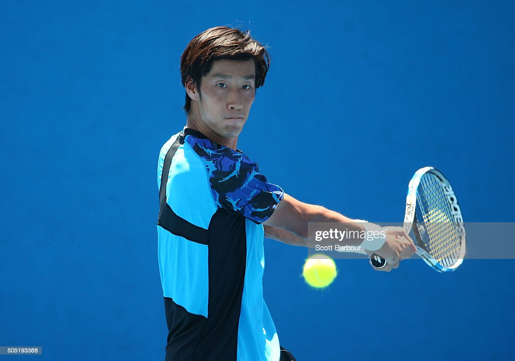 Yuichi Sugita of Japan plays a backhand in his match against Dennis Novikov of the United States during the third round of 2016 Australian Open Qualifying at Melbourne Park on January 16, 2016 in Melbourne, Australia.