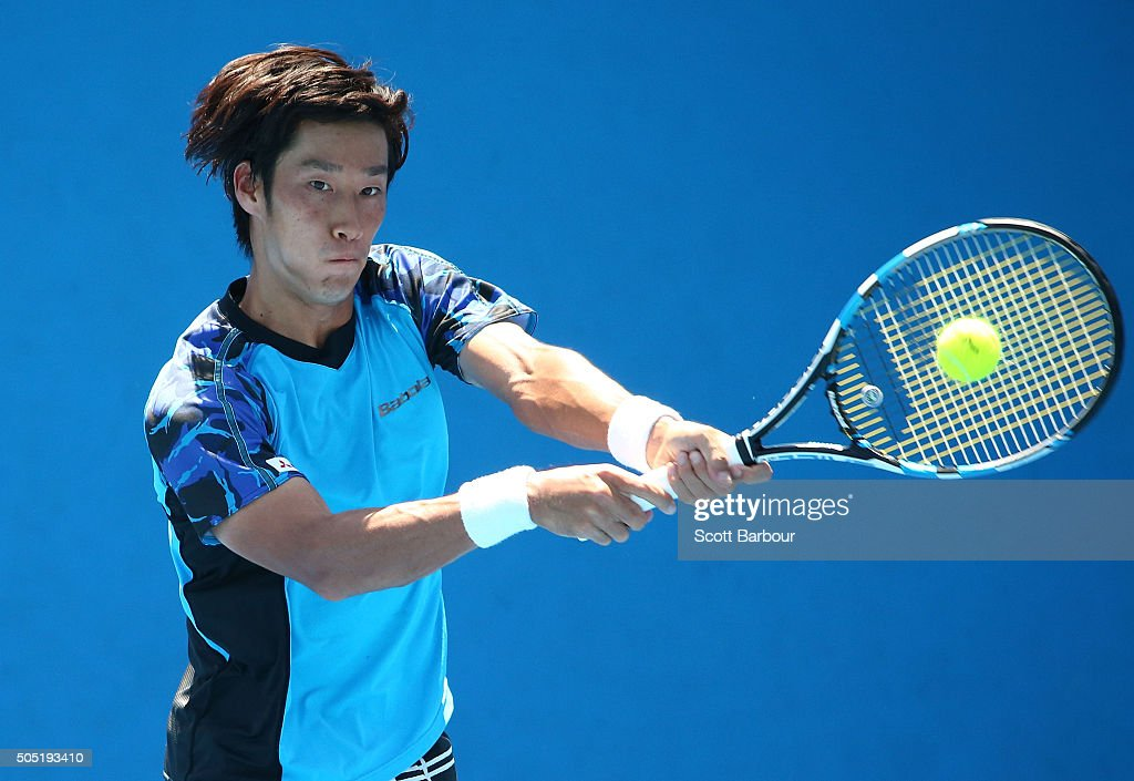 <a gi-track='captionPersonalityLinkClicked' href=/galleries/search?phrase=Yuichi+Sugita&family=editorial&specificpeople=2081175 ng-click='$event.stopPropagation()'>Yuichi Sugita</a> of Japan plays a backhand in his match against Dennis Novikov of the United States during the third round of 2016 Australian Open Qualifying at Melbourne Park on January 16, 2016 in Melbourne, Australia.