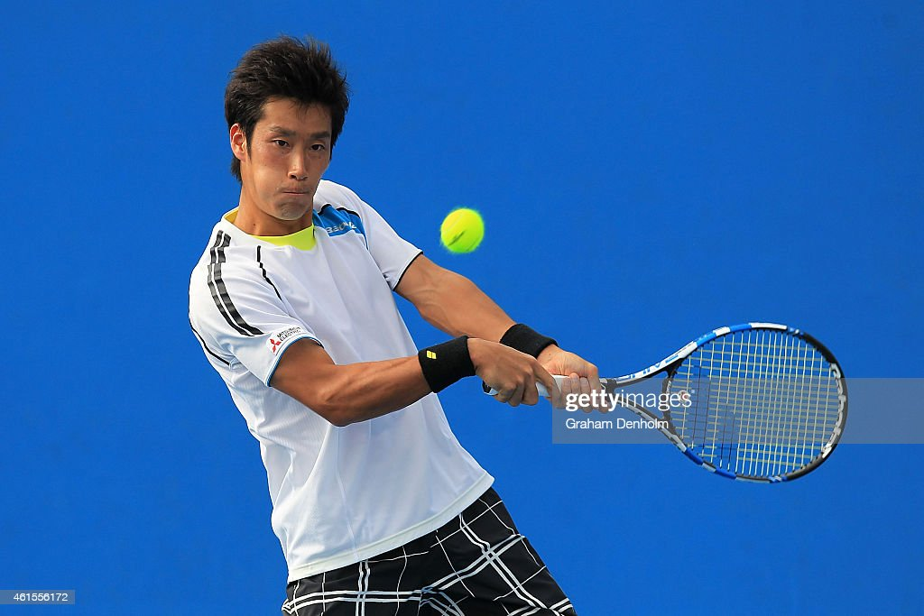 Yuichi Sugita of Japan plays a backhand in his qualifying match against Josef Kovalik of Slovakia for the 2015 Australian Open at Melbourne Park on January 15, 2015 in Melbourne, Australia.