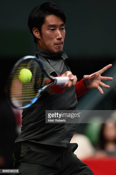 Yuichi Sugita of Japan plays a forehand against Benoit Paire of France during day two of the Rakuten Open at Ariake Coliseum on October 3 2017 in...