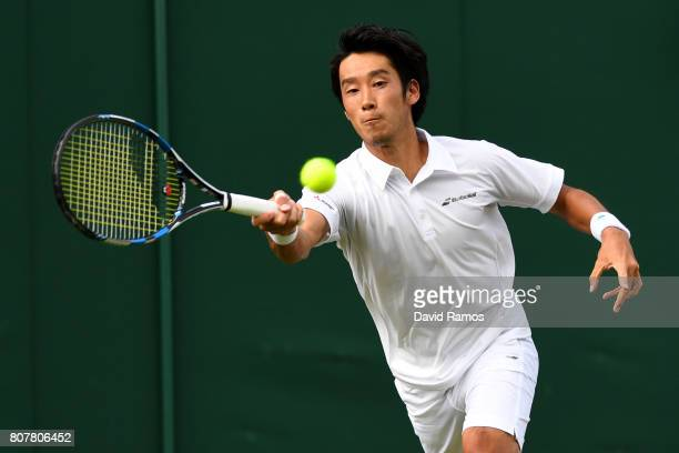 Yuichi Sugita of Japan plays a forehand during the Gentlemen's Singles first round match against Brydan Klein of Great Britian on day two of the...