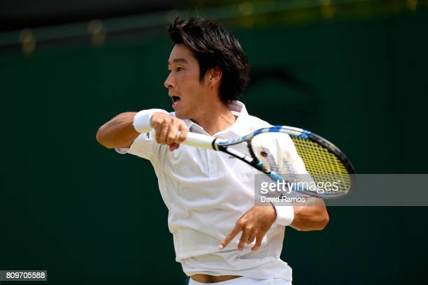 Yuichi Sugita of Japan plays a forehand during the Gentlemen's Singles second round match against Adrian Mannarino of France on day four of the...