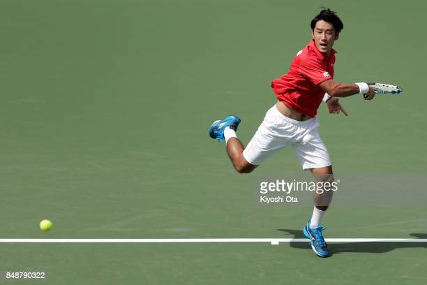 Yuichi Sugita of Japan plays a forehand in his singles match against Thiago Monteiro of Brazil during day four of the Davis Cup World Group Playoff...