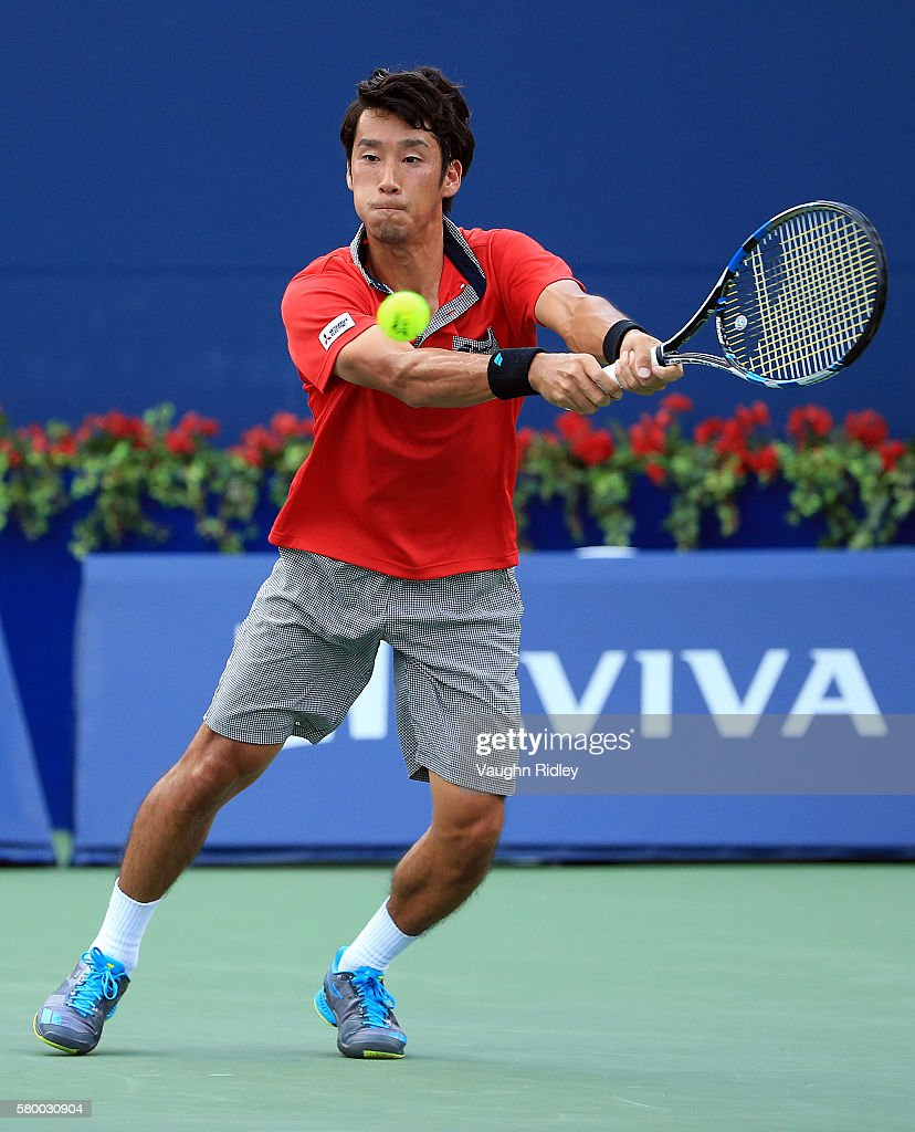Yuichi Sugita of Japan plays a shot against Grigor Dimitrov of Bulgaria during Day 1 of the Rogers Cup at the Aviva Centre on July 25 2016 in Toronto...