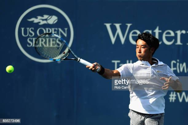 Yuichi Sugita of Japan plays a shot against Grigor Dimitrov of Bulgaria during Day 7 of the Western and Southern Open at the Linder Family Tennis...
