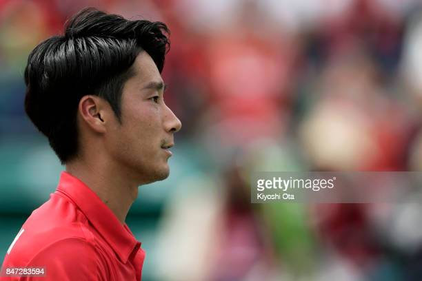 Yuichi Sugita of Japan plays in his singles match against Guilherme Clezar of Brazil during day one of the Davis Cup World Group Playoff between...