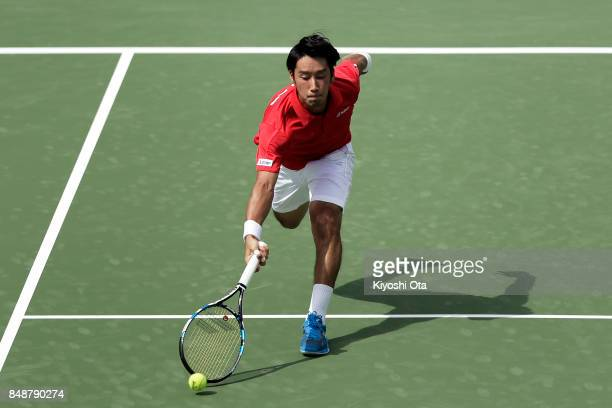 Yuichi Sugita of Japan plays in his singles match against Thiago Monteiro of Brazil during day four of the Davis Cup World Group Playoff between...